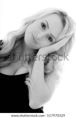 Portrait of a Girl Day Dreaming and Looking Peaceful and Relaxed Against a White Background