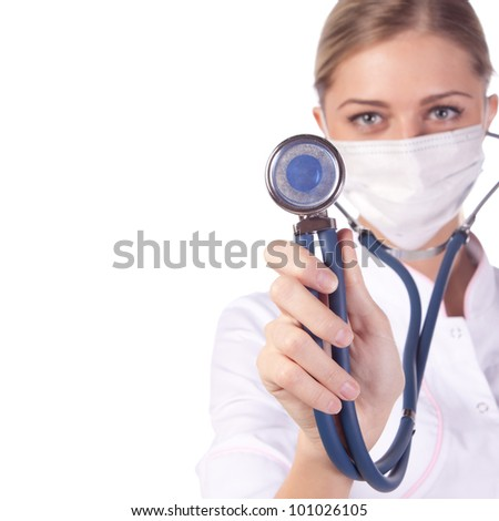 Portrait of a girl doctor in a mask.
