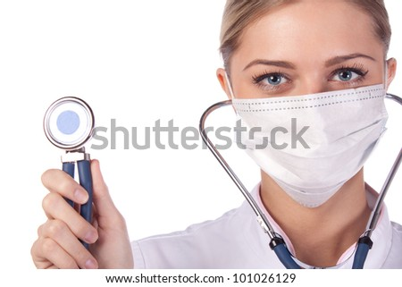 Portrait of a girl doctor in a mask. - stock photo