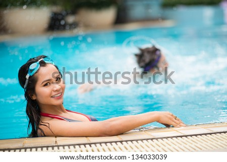 Portrait of a girl having fun in the swimming pool - stock photo
