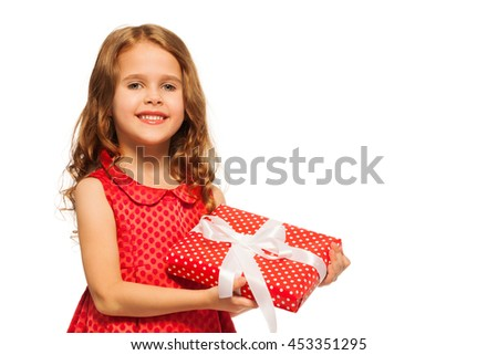 Portrait of a girl hold small present on white