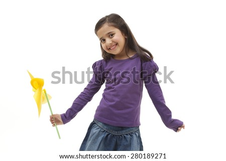 Portrait of a girl holding a toy windmill - stock photo