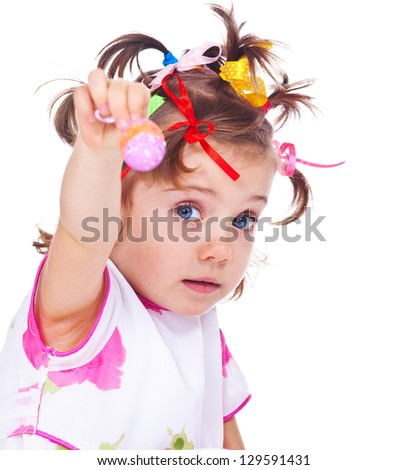 Portrait of a girl holding Easter egg in hand - stock photo