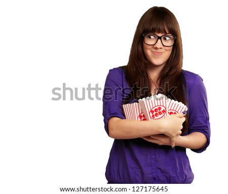 Portrait Of A Girl Holding Popcorn Packets And Smiling On White Background - stock photo
