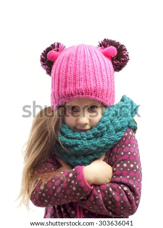 Portrait of a girl in a cap and scarf . Isolated background.