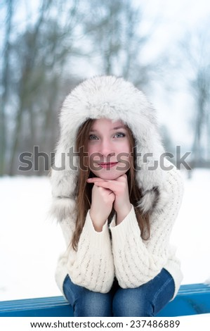 portrait of a girl in a cap with earflaps - stock photo