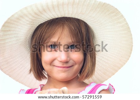 Portrait of a girl in a hat on light background - stock photo