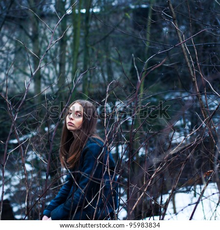 portrait of a girl in a mysterious place - stock photo