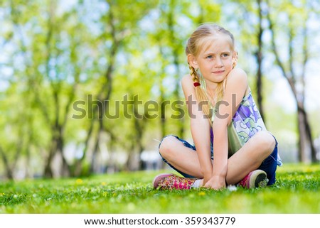 portrait of a girl in a park - stock photo