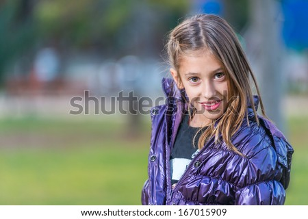 Portrait of a girl in a park outdoors