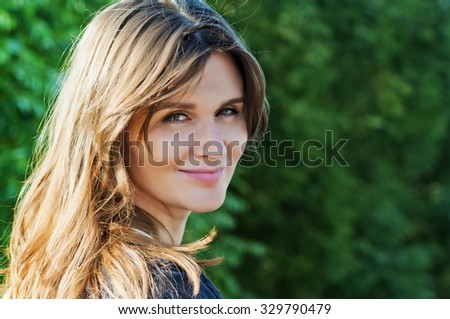 portrait of a girl in a summer park , close-up - stock photo
