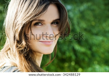 portrait of a girl in a summer park , close-up