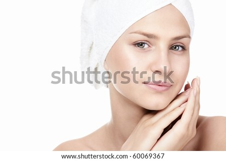 Portrait of a girl in a towel on a white background - stock photo