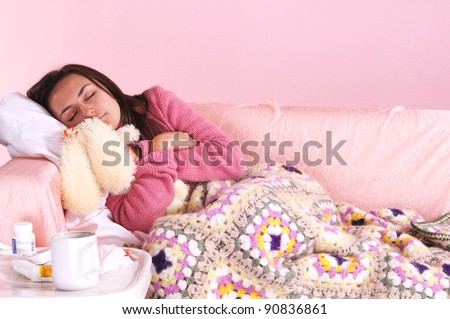 portrait of a girl in bed with toy - stock photo
