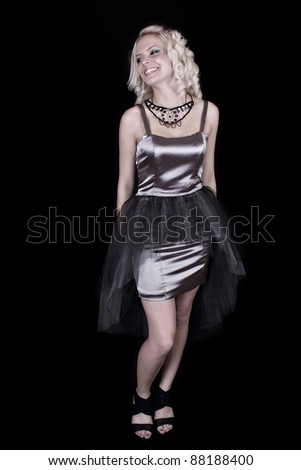 Portrait of a girl in front of black background