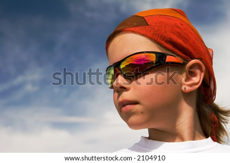 portrait of a girl in red bandanna - stock photo