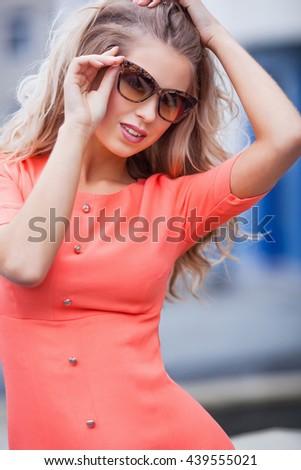 Portrait of a girl in sunglasses - stock photo
