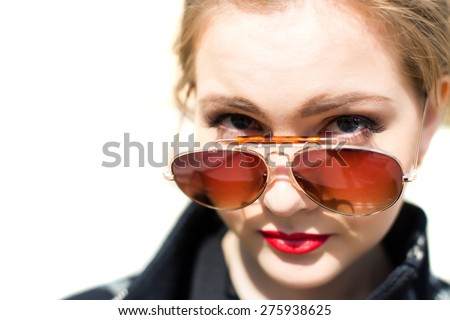 Portrait of a girl in sunglasses close-up, shallow depth of field - stock photo