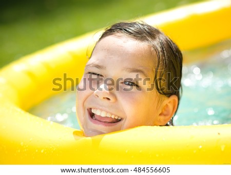 Portrait of a girl in swimming pool, outdoor shoot