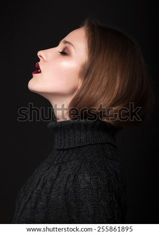 Portrait of a girl in the studio. Glossy Photo - stock photo