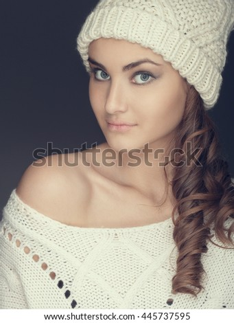 portrait of a girl in white winter hat and sweater - stock photo