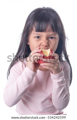 portrait of a girl kid  butting a red apple on white background