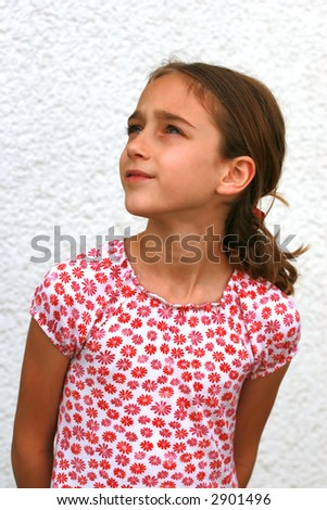 Portrait of a girl looking away - stock photo