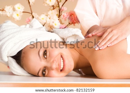 portrait of a girl lying and taking massage - stock photo