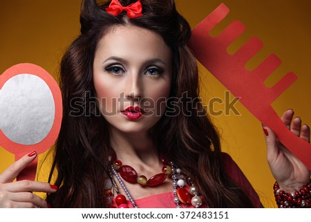 Portrait of a girl model in a beautiful dress and decoration. Beauty, style, fashion, glamor, doll. - stock photo
