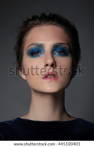 Portrait of a girl model with blue make-up. Eyeshadow, Bright. - stock photo