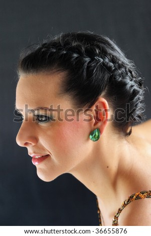 portrait of a girl on black background - stock photo