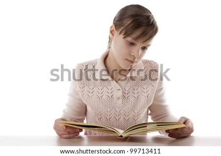 Portrait of a girl reading with enthusiasm