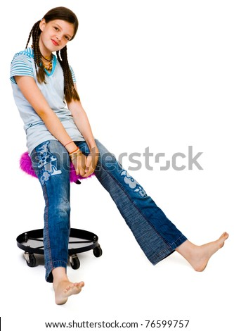 Portrait of a girl sitting on a stool and smiling isolated over white - stock photo