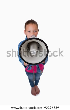 Portrait of a girl speaking through a megaphone against a white background - stock photo