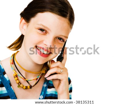 Portrait of a girl talking on a mobile phone isolated over white - stock photo