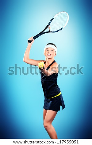 Portrait of a girl tennis player holding tennis racket and tennis ball. Studio shot. - stock photo