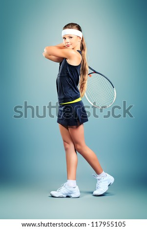 Portrait of a girl tennis player holding tennis racket. Studio shot. - stock photo