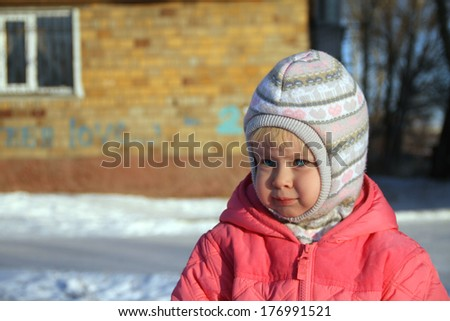 Portrait of a Girl TREE years for a walk in winter - stock photo