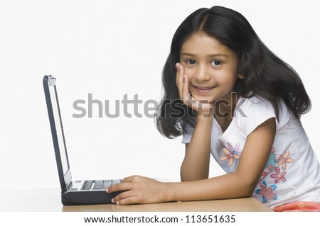 Portrait of a girl using a laptop - stock photo