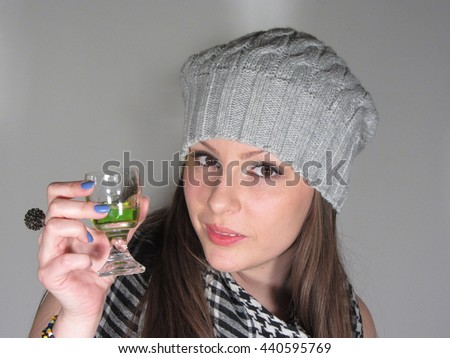 Portrait of a girl wearing grey winter cap and a scarf - stock photo