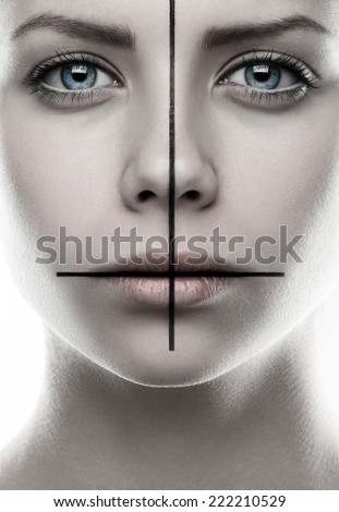 Portrait of a girl with a cross on the face, make-up cross, inverted cross, the symbol of St. Peter, St. Peter's cross, white background, isolated, religion, vampire - stock photo