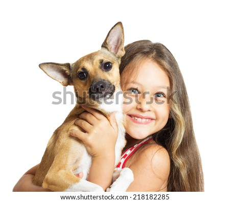 portrait of a girl with a dog in her arms - stock photo