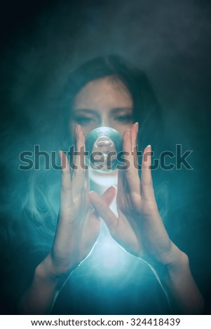 Portrait of a girl with a glass ball - stock photo
