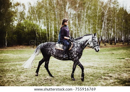 portrait of a girl with a horse outdoors