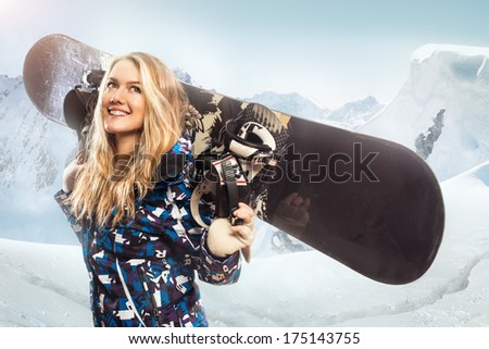 Portrait of a girl with a snowboard in the mountains - stock photo
