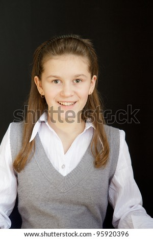 portrait of a girl with a white blouse and a gray vest