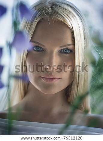 Portrait of a girl with blue and white flowers