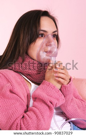 portrait of a girl with breathing mask - stock photo