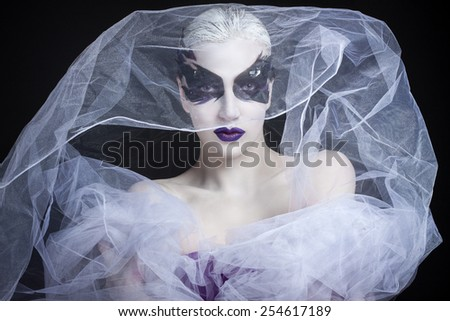 portrait of a girl with creative make-up in a veil - stock photo