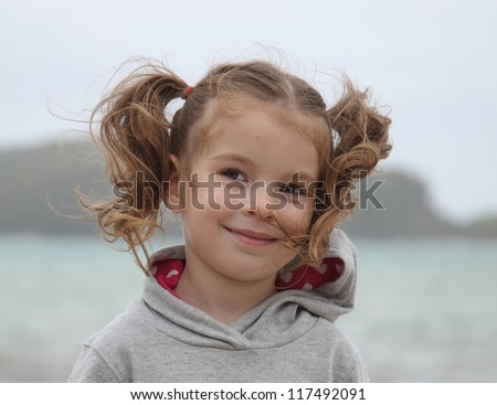 Portrait of a girl with developing hair in the wind - stock photo